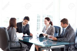 10218982-four-business-people-during-a-meeting