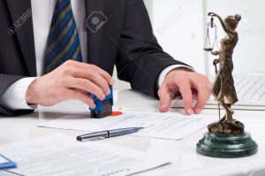 12554743-notary-public-signing-document-at-his-workplace