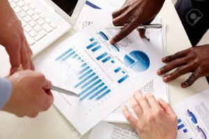 14458232-business-people-discussing-the-charts-and-graphs-showing-the-results-of-their-successful-teamwork