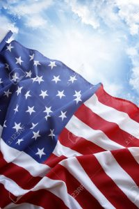 22268995-american-flag-in-front-of-blue-sky