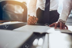 47840978-close-up-business-man-signing-contract-making-a-deal-classic-business
