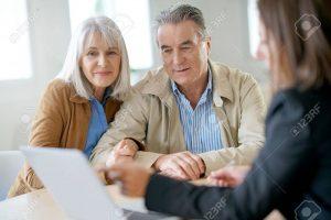 69227266-senior-couple-meeting-financial-adviser-for-investment