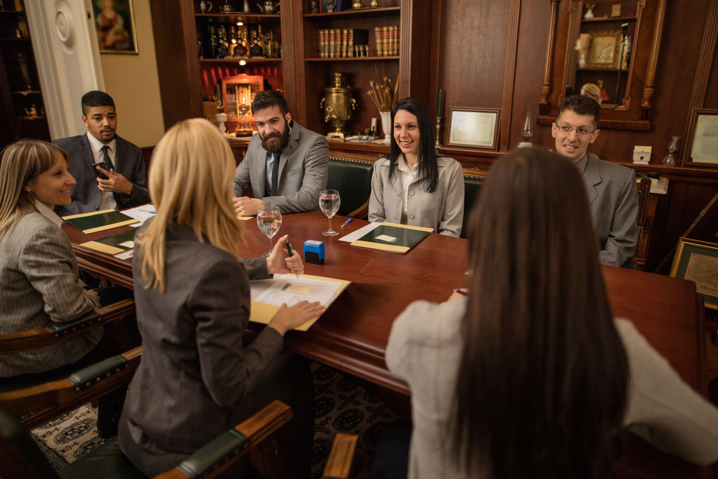 group of business people or lawyers – meeting in an office