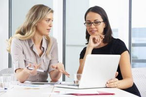 Two Businesswomen Meeting In Office